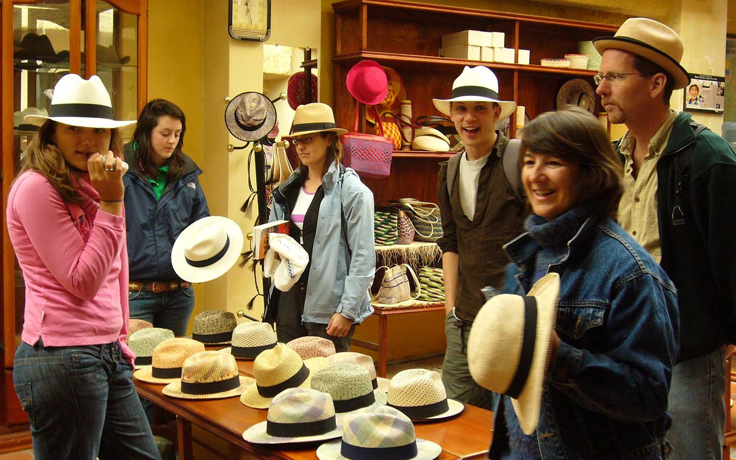 Spanish students trying on Panama Hats during a cultural field trip