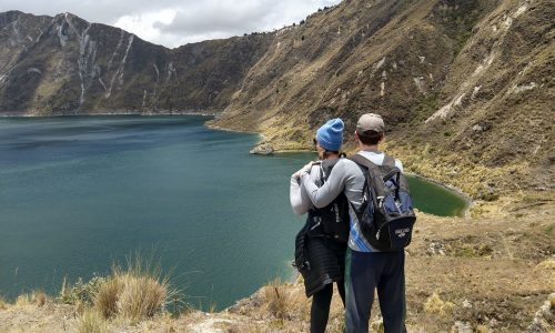 A couple at enjoying the romantic view of Quilotoa