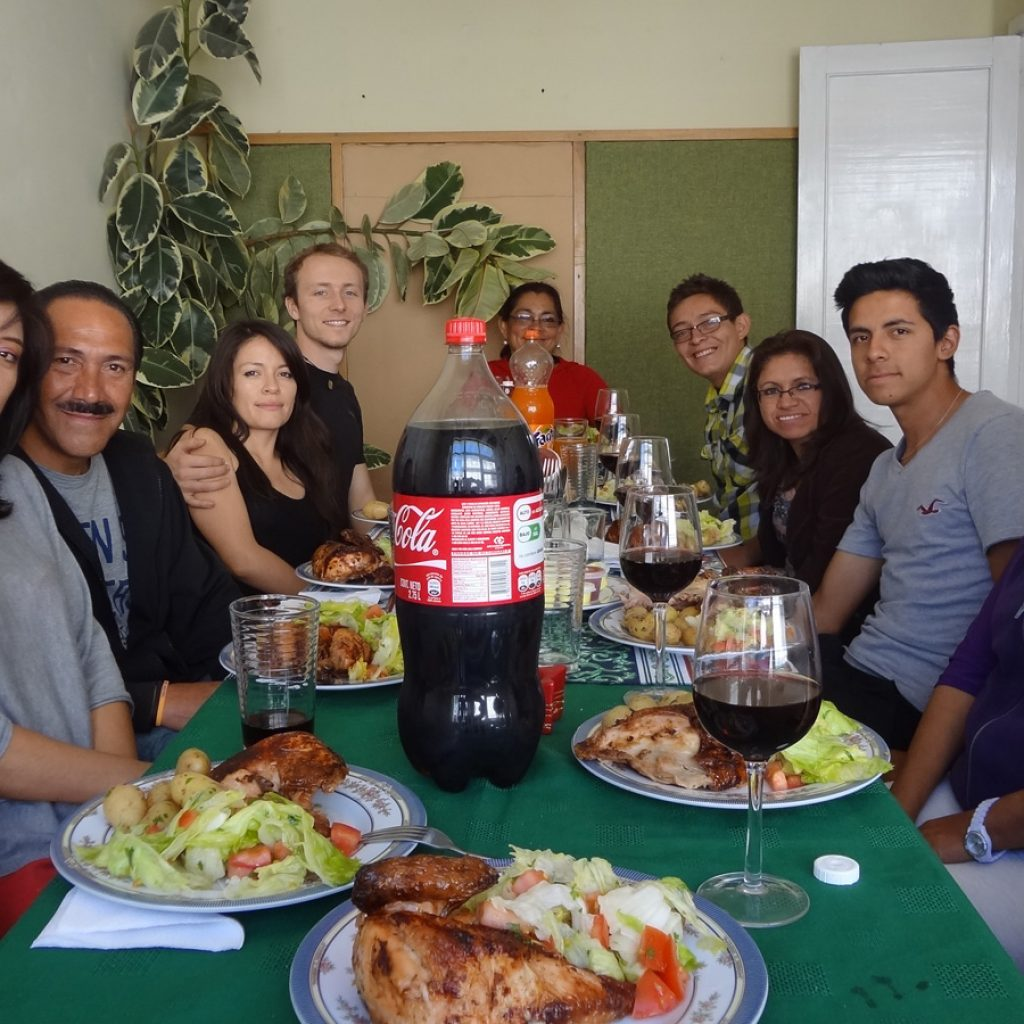 Students and teachers enjoying a traditional Ecuadorian meal at a homestay