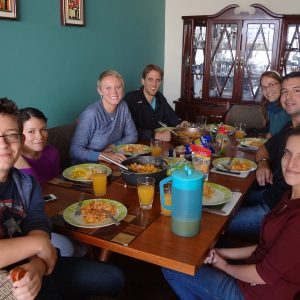 Students enjoying breakfast with their Ecuadorian Homestay family
