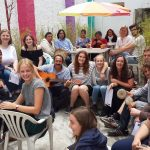 A group of students singing cultural Ecuadorian songs in Vida Verde's patio